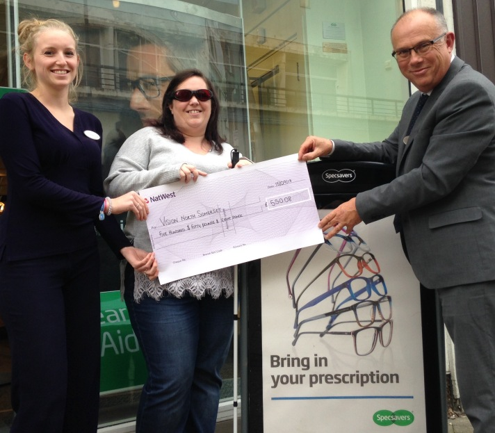 Photo of Claire being presented with a cheque