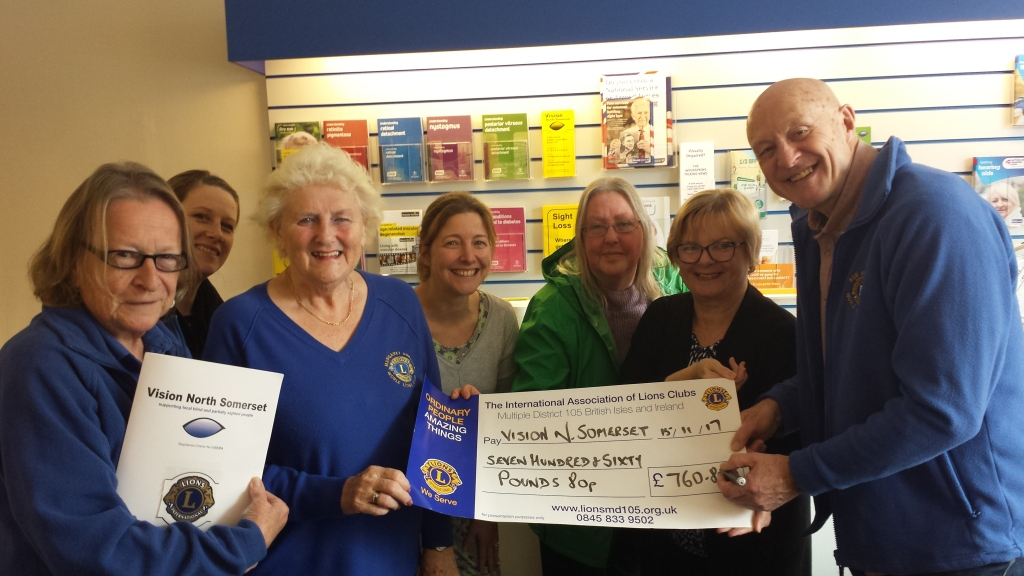 Image of Worle Lions presenting a cheque to Vision North Somerset